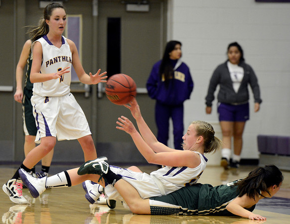 """Boulder High School's Lena Jaycox passes the ball after fighting for a loose ball with Daneeca Medina during a game against Bear Creek High School on Tuesday, Feb. 26, in Boulder. For more photos of the game go to  <a href=""""http://www.dailycamera.com"""">http://www.dailycamera.com</a><br /> Jeremy Papasso/ Camera"""