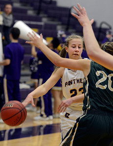 Boulder High School's Lena Jaycox sneaks a pass under the arms of Ariana Green during a game against Bear Creek High School on Tuesday, Feb. 26, in Boulder. For more photos of the game go to www.dailycamera.com Jeremy Papasso/ Camera
