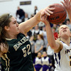 "Boulder High School's Lena Jaycox gets fouled by Amber Gary during a game against Bear Creek High School on Tuesday, Feb. 26, in Boulder. For more photos of the game go to  <a href=""http://www.dailycamera.com"">http://www.dailycamera.com</a><br /> Jeremy Papasso/ Camera"