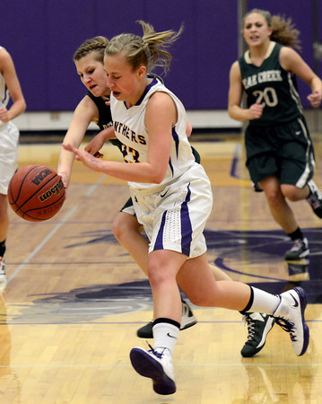 "Boulder High School's Lena Jaycox goes for a loose ball against Edina Krusko during a game against Bear Creek High School on Tuesday, Feb. 26, in Boulder. For more photos of the game go to  <a href=""http://www.dailycamera.com"">http://www.dailycamera.com</a><br /> Jeremy Papasso/ Camera"