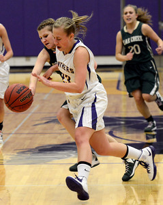 Boulder High School's Lena Jaycox goes for a loose ball against Edina Krusko during a game against Bear Creek High School on Tuesday, Feb. 26, in Boulder. For more photos of the game go to www.dailycamera.com Jeremy Papasso/ Camera