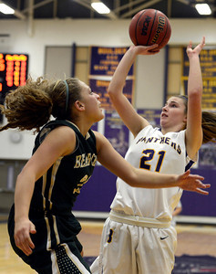 Boulder High School's Mariah Alexander takes a shot over Ariana Green during a game against Bear Creek High School on Tuesday, Feb. 26, in Boulder. For more photos of the game go to www.dailycamera.com Jeremy Papasso/ Camera