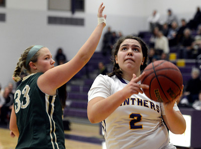 Boulder High School's Vivi Gregorich drives to the hoop past Mackenzie Haydon during a game against Bear Creek High School on Tuesday, Feb. 26, in Boulder. For more photos of the game go to www.dailycamera.com Jeremy Papasso/ Camera