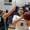 "Boulder High School's Vivi Gregorich drives to the hoop past Mackenzie Haydon during a game against Bear Creek High School on Tuesday, Feb. 26, in Boulder. For more photos of the game go to  <a href=""http://www.dailycamera.com"">http://www.dailycamera.com</a><br /> Jeremy Papasso/ Camera"