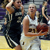 "Boulder High School's Lena Jaycox drives to the hoop past Ariana Green during a game against Bear Creek High School on Tuesday, Feb. 26, in Boulder. For more photos of the game go to  <a href=""http://www.dailycamera.com"">http://www.dailycamera.com</a><br /> Jeremy Papasso/ Camera"
