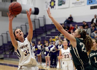 Boulder High School's Jacque Szarmach takes a shot over Ariana Green during a game against Bear Creek High School on Tuesday, Feb. 26, in Boulder. For more photos of the game go to www.dailycamera.com Jeremy Papasso/ Camera
