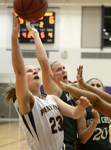 Boulder High School's Lena Jaycox takes a shot over a swarm of defenders including Ariana Green, No. 20, during a game against Bear Creek High School on Tuesday, Feb. 26, in Boulder. For more photos of the game go to www.dailycamera.com Jeremy Papasso/ Camera