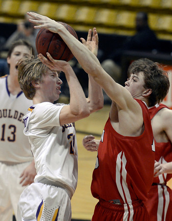 "Boulder High School's Kevin VanLieshout gets fouled by Sam Martin during a game against Fairview High School on Friday, Feb. 15, at the Coors Event Center on the University of Colorado campus in Boulder. For more photos of the game go to  <a href=""http://www.dailycamera.com"">http://www.dailycamera.com</a><br /> Jeremy Papasso/ Camera"