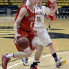 "Fairview High School's Austin Sparks drives to the hoop past Joe Szarmach during a game against Boulder High School on Friday, Feb. 15, at the Coors Event Center on the University of Colorado campus in Boulder. For more photos of the game go to  <a href=""http://www.dailycamera.com"">http://www.dailycamera.com</a><br /> Jeremy Papasso/ Camera"