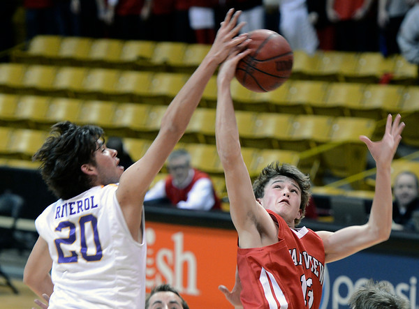 "Fairview High School's Sam Martin snags a rebound over Diego Riverol during a game against Boulder High School on Friday, Feb. 15, at the Coors Event Center on the University of Colorado campus in Boulder. For more photos of the game go to  <a href=""http://www.dailycamera.com"">http://www.dailycamera.com</a><br /> Jeremy Papasso/ Camera"