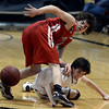 "Boulder High School's RJ Lampert fights for a loose ball with Gabe Tierney during a game against Fairview High School on Friday, Feb. 15, at the Coors Event Center on the University of Colorado campus in Boulder. For more photos of the game go to  <a href=""http://www.dailycamera.com"">http://www.dailycamera.com</a><br /> Jeremy Papasso/ Camera"