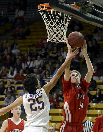 "Fairview High School's Dakota Pilkington takes a shot over Alejandro Rodriguez during a game against Boulder High School on Friday, Feb. 15, at the Coors Event Center on the University of Colorado campus in Boulder. For more photos of the game go to  <a href=""http://www.dailycamera.com"">http://www.dailycamera.com</a><br /> Jeremy Papasso/ Camera"