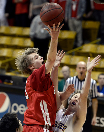 "Fairview High School's Brent Wrapp takes a shot over Jonah Charnick during a game against Boulder High School on Friday, Feb. 15, at the Coors Event Center on the University of Colorado campus in Boulder. For more photos of the game go to  <a href=""http://www.dailycamera.com"">http://www.dailycamera.com</a><br /> Jeremy Papasso/ Camera"