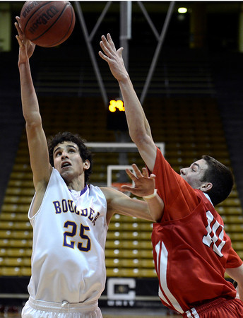 "Boulder High School's Alejandro Rodriguez takes a shot over Trevor McQueeney during a game against Fairview High School on Friday, Feb. 15, at the Coors Event Center on the University of Colorado campus in Boulder. For more photos of the game go to  <a href=""http://www.dailycamera.com"">http://www.dailycamera.com</a><br /> Jeremy Papasso/ Camera"