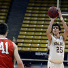 "Boulder High School's Alejandro Rodriguez shoots a three pointer in front of Austin Sparks during a game against Fairview High School on Friday, Feb. 15, at the Coors Event Center on the University of Colorado campus in Boulder. For more photos of the game go to  <a href=""http://www.dailycamera.com"">http://www.dailycamera.com</a><br /> Jeremy Papasso/ Camera"