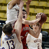 "Fairview High School's Miles MacKenzie tries to take a shot over Jonah Charnick during a game against Boulder High School on Friday, Feb. 15, at the Coors Event Center on the University of Colorado campus in Boulder. For more photos of the game go to  <a href=""http://www.dailycamera.com"">http://www.dailycamera.com</a><br /> Jeremy Papasso/ Camera"