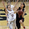 "Fairview High School's Annika Lai drives to the hoop past Jacque Szarmach during a game against Boulder High School on Friday, Feb. 15, at the Coors Event Center on the University of Colorado campus in Boulder. For more photos of the game go to  <a href=""http://www.dailycamera.com"">http://www.dailycamera.com</a><br /> Jeremy Papasso/ Camera"