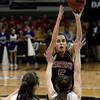 "Fairview High School's Annika Lai takes a shot over Sarah Burns during a game against Boulder High School on Friday, Feb. 15, at the Coors Event Center on the University of Colorado campus in Boulder. For more photos of the game go to  <a href=""http://www.dailycamera.com"">http://www.dailycamera.com</a><br /> Jeremy Papasso/ Camera"