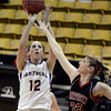"Boulder High School's Courtney Van Bussum takes a shot over Georgina Ryder during a game against Fairview High School on Friday, Feb. 15, at the Coors Event Center on the University of Colorado campus in Boulder. For more photos of the game go to  <a href=""http://www.dailycamera.com"">http://www.dailycamera.com</a><br /> Jeremy Papasso/ Camera"