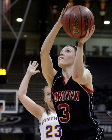 """Fairview High School's Katie Kuosman goes for a layup in front of Lena Jaycox during a game against Boulder High School on Friday, Feb. 15, at the Coors Event Center on the University of Colorado campus in Boulder. For more photos of the game go to  <a href=""""http://www.dailycamera.com"""">http://www.dailycamera.com</a><br /> Jeremy Papasso/ Camera"""