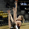 "Fairview High School's Georgina Ryder takes a shot over Courtney Van Bussum during a game against Boulder High School on Friday, Feb. 15, at the Coors Event Center on the University of Colorado campus in Boulder. For more photos of the game go to  <a href=""http://www.dailycamera.com"">http://www.dailycamera.com</a><br /> Jeremy Papasso/ Camera"