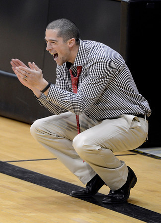 """Fairview High School Head Coach Andre Goldberg shows his excitement in the last few seconds of a game against Boulder High School on Friday, Feb. 15, at the Coors Event Center on the University of Colorado campus in Boulder. Fairview won the game. For more photos of the game go to  <a href=""""http://www.dailycamera.com"""">http://www.dailycamera.com</a><br /> Jeremy Papasso/ Camera"""