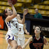 "Boulder High School's Sarah Burns goes for a layup over Sarah Kaufman during a game against Fairview High School on Friday, Feb. 15, at the Coors Event Center on the University of Colorado campus in Boulder. For more photos of the game go to  <a href=""http://www.dailycamera.com"">http://www.dailycamera.com</a><br /> Jeremy Papasso/ Camera"