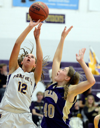 "Boulder High School's Courtney Van Bussum takes a shot over Ashley Evans during a game against Fort Collins High School on Tuesday, Jan. 29, in Boulder. For more photos of the game go to  <a href=""http://www.dailycamera.com"">http://www.dailycamera.com</a><br /> Jeremy Papasso/ Camera"