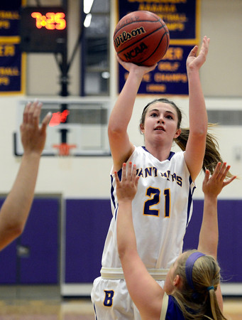 """Boulder High School's Mariah Alexander takes a shot over Sydney Thorp, at right, during a game against Fort Collins High School on Tuesday, Jan. 29, in Boulder. For more photos of the game go to  <a href=""""http://www.dailycamera.com"""">http://www.dailycamera.com</a><br /> Jeremy Papasso/ Camera"""