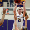 "Boulder High School's Mariah Alexander takes a shot over Sydney Thorp, at right, during a game against Fort Collins High School on Tuesday, Jan. 29, in Boulder. For more photos of the game go to  <a href=""http://www.dailycamera.com"">http://www.dailycamera.com</a><br /> Jeremy Papasso/ Camera"