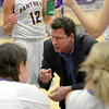 "Boulder High School Head Coach Ron Burgin talks with his team during a time out in a game against Fort Collins High School on Tuesday, Jan. 29, in Boulder. For more photos of the game go to  <a href=""http://www.dailycamera.com"">http://www.dailycamera.com</a><br /> Jeremy Papasso/ Camera"