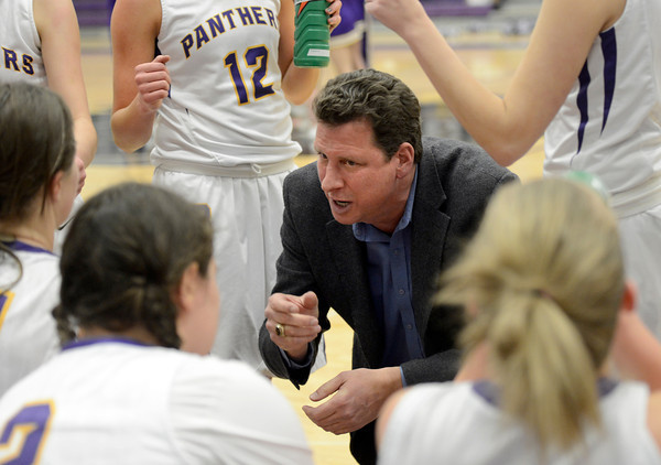"""Boulder High School Head Coach Ron Burgin talks with his team during a time out in a game against Fort Collins High School on Tuesday, Jan. 29, in Boulder. For more photos of the game go to  <a href=""""http://www.dailycamera.com"""">http://www.dailycamera.com</a><br /> Jeremy Papasso/ Camera"""
