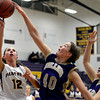 "Boulder High School's Courtney Van Bussum gets her shot blocked by Ashley Evans during a game against Fort Collins High School on Tuesday, Jan. 29, in Boulder. For more photos of the game go to  <a href=""http://www.dailycamera.com"">http://www.dailycamera.com</a><br /> Jeremy Papasso/ Camera"