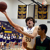 "Boulder High School's Diego Riverol takes a shot in front of Elijah Hewlett during a game against George Washington High School on Wednesday, Feb. 27, in Boulder. For more photos of the game go to  <a href=""http://www.dailycamera.com"">http://www.dailycamera.com</a><br /> Jeremy Papasso/ Camera"