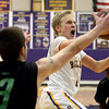 "Boulder High School's Garrett Turner drives to the hoop past McCay Gordon, No. 3, during a game against George Washington High School on Wednesday, Feb. 27, in Boulder. For more photos of the game go to  <a href=""http://www.dailycamera.com"">http://www.dailycamera.com</a><br /> Jeremy Papasso/ Camera"