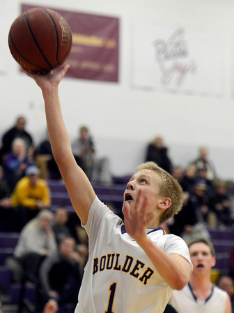 "Boulder High School's Garrett Turner goes for a layup during a game against George Washington High School on Wednesday, Feb. 27, in Boulder. For more photos of the game go to  <a href=""http://www.dailycamera.com"">http://www.dailycamera.com</a><br /> Jeremy Papasso/ Camera"