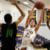 "Boulder High School's Alejandro Rodriguez takes a shot in front of Elijah Hewlett, No. 14, during a game against George Washington High School on Wednesday, Feb. 27, in Boulder. For more photos of the game go to  <a href=""http://www.dailycamera.com"">http://www.dailycamera.com</a><br /> Jeremy Papasso/ Camera"