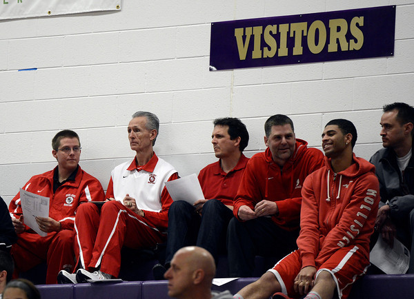 """Regis Jesuit Head Coach Ken Shaw, second from left, and other staff members take notes as they watch Boulder High School play George Washington High School in a boys basketball game on Wednesday, Feb. 27, in Boulder. Boulder is scheduled to play Regis next in the state tournament. For more photos of the game go to  <a href=""""http://www.dailycamera.com"""">http://www.dailycamera.com</a><br /> Jeremy Papasso/ Camera"""