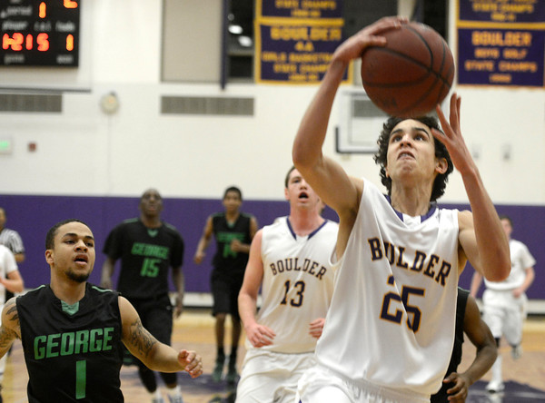 "Boulder High School's Alejandro Rodriguez goes for a layup in front of Michael Hudgens, No. 1, during a game against George Washington High School on Wednesday, Feb. 27, in Boulder. For more photos of the game go to  <a href=""http://www.dailycamera.com"">http://www.dailycamera.com</a><br /> Jeremy Papasso/ Camera"
