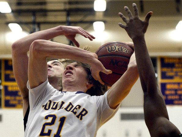 """Boulder High School's Kevin VanLieshout gets fouled by McCay Gordon during a game against George Washington High School on Wednesday, Feb. 27, in Boulder. For more photos of the game go to  <a href=""""http://www.dailycamera.com"""">http://www.dailycamera.com</a><br /> Jeremy Papasso/ Camera"""