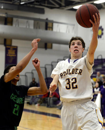 "Boulder High School's Cooper Bohm goes for a layup in front of Jevon Taylor  during a game against George Washington High School on Wednesday, Feb. 27, in Boulder. For more photos of the game go to  <a href=""http://www.dailycamera.com"">http://www.dailycamera.com</a><br /> Jeremy Papasso/ Camera"