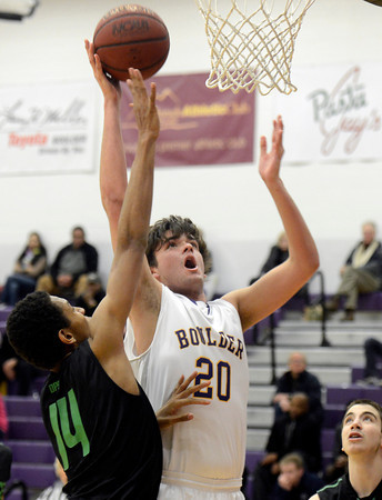 "Boulder High School's Diego Riverol takes a shot over Elijah Hewlett during a game against George Washington High School on Wednesday, Feb. 27, in Boulder. For more photos of the game go to  <a href=""http://www.dailycamera.com"">http://www.dailycamera.com</a><br /> Jeremy Papasso/ Camera"