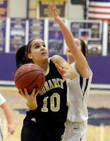 "Monarch High School's Ellie Dietz drives to the hoop during a game against Boulder High School on Tuesday, Feb. 12, at Boulder High School. For more photos of the game go to  <a href=""http://www.dailycamera.com"">http://www.dailycamera.com</a><br /> Jeremy Papasso/ Camera"