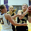 "Monarch High School's Bridget Anthony drives to the hoop past Lena Jaycox during a game against Boulder High School on Tuesday, Feb. 12, at Boulder High School. For more photos of the game go to  <a href=""http://www.dailycamera.com"">http://www.dailycamera.com</a><br /> Jeremy Papasso/ Camera"