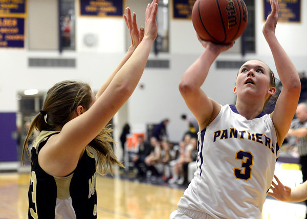 "Boulder High School's Sarah Burns takes a shot over Bridget Anthony during a game against Monarch High School on Tuesday, Feb. 12, at Boulder High School. For more photos of the game go to  <a href=""http://www.dailycamera.com"">http://www.dailycamera.com</a><br /> Jeremy Papasso/ Camera"