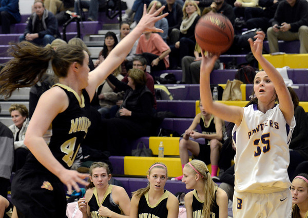 "Boulder High School's Jacque Szarmach takes a shot over Jordan Eisler during a game against Monarch High School on Tuesday, Feb. 12, at Boulder High School. For more photos of the game go to  <a href=""http://www.dailycamera.com"">http://www.dailycamera.com</a><br /> Jeremy Papasso/ Camera"