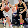 "Boulder High School's Lena Jaycox dribbles past Ellie Dietz during a game against Monarch High School on Tuesday, Feb. 12, at Boulder High School. For more photos of the game go to  <a href=""http://www.dailycamera.com"">http://www.dailycamera.com</a><br /> Jeremy Papasso/ Camera"
