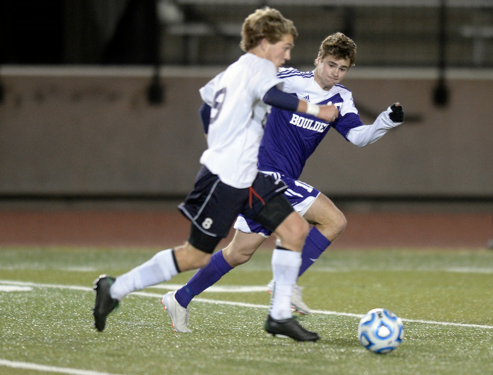 . Boulder High School\'s Quinn Liebmann plays defense on Jack Reynolds during a semi-final game against Pine Creek High School on Wednesday, Nov. 6, at Cherokee Trail High School in Aurora. Boulder lost the game 1-0. For more photos of the game go to www.dailycamera.com Jeremy Papasso/ Camera