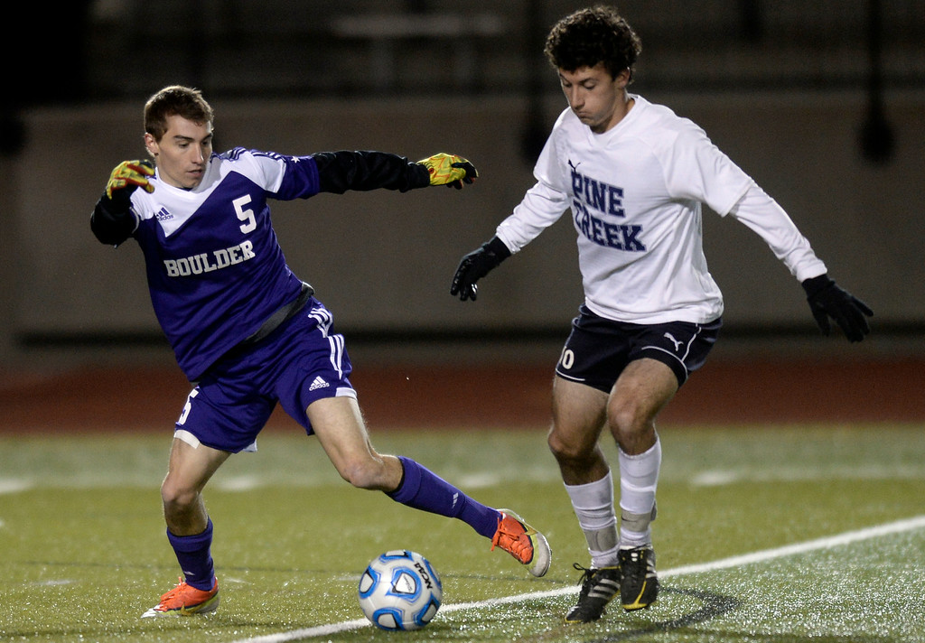 . Boulder High School\'s Mason Douillard moves the ball past Alexander Cullen during a semi-final game against Pine Creek High School on Wednesday, Nov. 6, at Cherokee Trail High School in Aurora. Boulder lost the game 1-0. For more photos of the game go to www.dailycamera.com Jeremy Papasso/ Camera