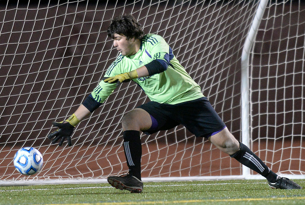 . Boulder High School goalkeeper Henry Huettel misses the game winning goal during a semi-final game against Pine Creek High School on Wednesday, Nov. 6, at Cherokee Trail High School in Aurora. Boulder lost the game 1-0. For more photos of the game go to www.dailycamera.com Jeremy Papasso/ Camera